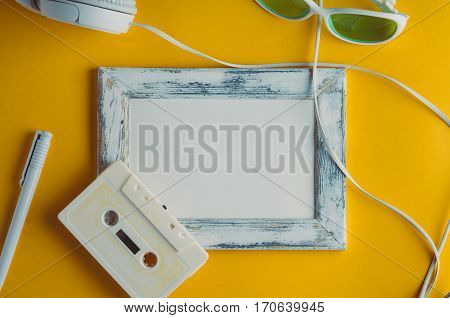 Audio Cassette And Headphones On A Yellow Background. Mock Up