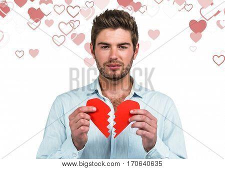 Portrait of depressed man holding broken heart
