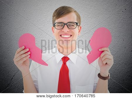 Crying man holding broken heart against textured background
