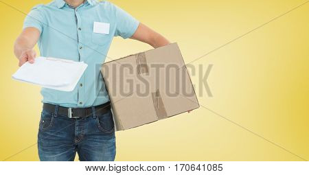 Mid section of delivery man with package giving clipboard for signature against yellow background