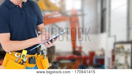 Mid section of handyman with tool belt writing on clipboard against digitally generated background