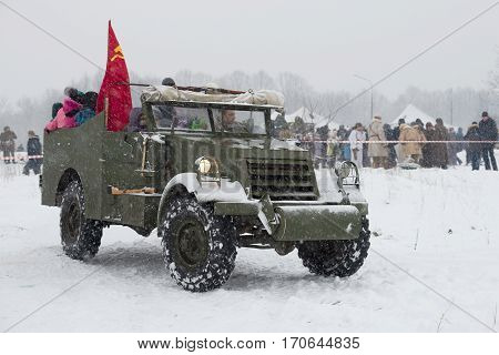 KRASNOE SELO, RUSSIA - JANUARY 15, 2017: Driving of children on the American armored prospecting M3A1
