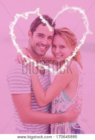 Composite image of couple embracing each other against pink background