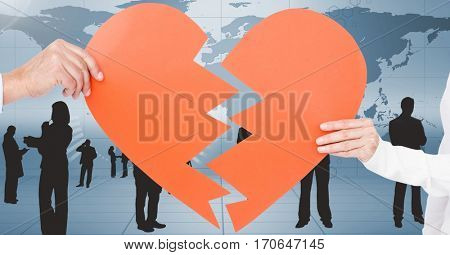 Hands of couple holding a broken heart against digitally generated background