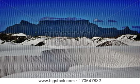 Landscape with white sand dune and Table Mountain in the background