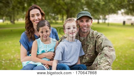 Soldier reunited with their family in park