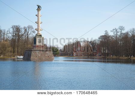 A view of the old Chesmensky column and the building of the Admiralty on the Big pond in the April afternoon. Tsarskoye Selo