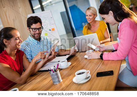 Casual business team using technology in the office
