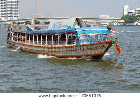 BANGKOK, THAILAND - DECEMBER 12, 2016: High-speed passenger shuttle boat on the Chao Phraya river close-up