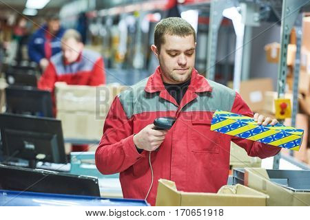 worker with laser barcode scanner at warehouse