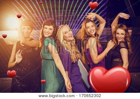Smiling friends dancing on dance floor against hearts