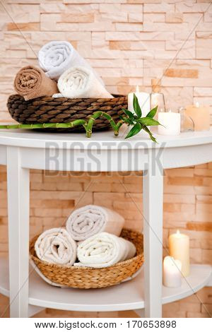 Beautiful spa composition with candles on white table