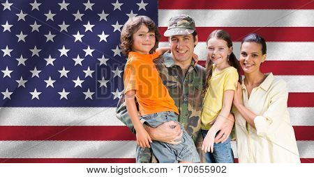 Portrait of happy family with arm around against american flag