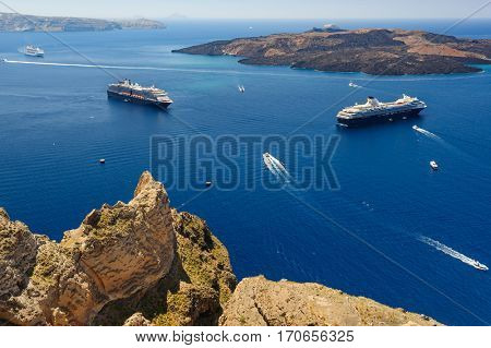 View from Fira coast to caldera sea with ships at background, Santorini Greece. Copyspace