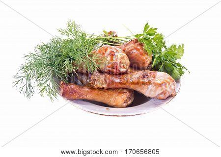 Portion of fried chicken drumsticks and vegetable garnish