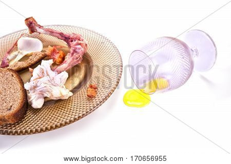 The remains of food in the afternoon on a plate isolated on white background