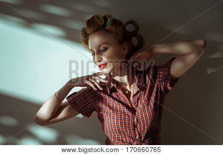 Emotional beautiful girl with caramel and curlers