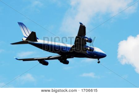 Airplane In A Blue Sky