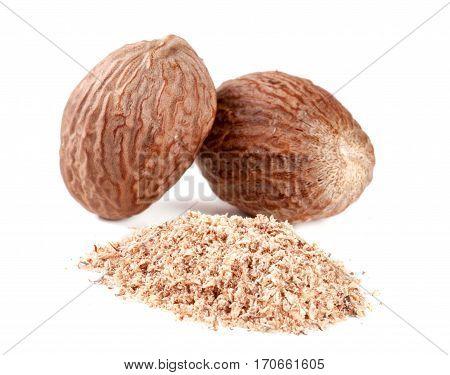 Two nutmeg and powder isolated on white background.
