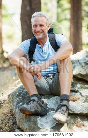 Hiker smiling and posing on the wood