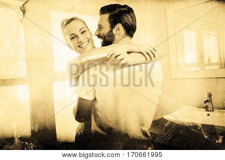 Grey background against woman holding pregnancy test while embracing man