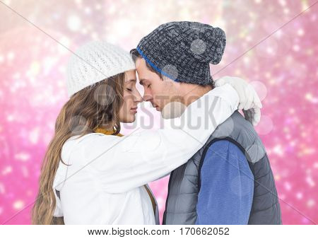 Affectionate couple embracing each other against digitally generated pink background