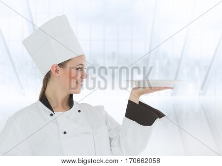 Female chafe holding plate against digitally generated background