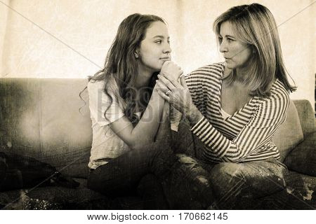 Grey background against mother comforting her daughter