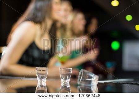 Three empty shooter glasses in a bar