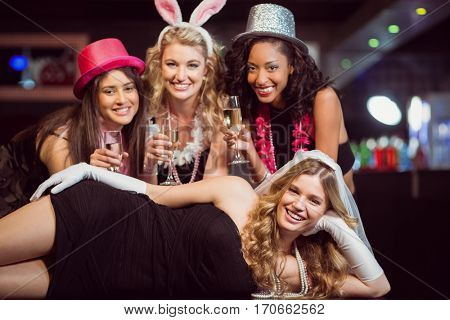 Friends celebrating bachelorette party in a nightclub