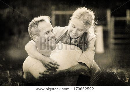 Grey background against husband giving piggy back to wife