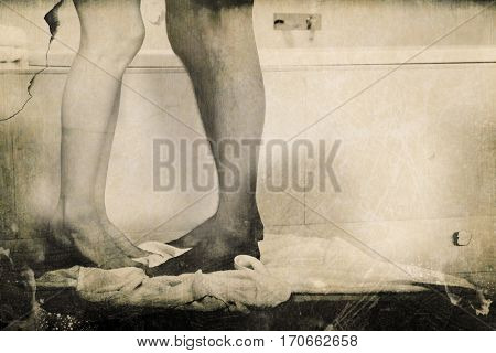 Grey background against low section of young couple bathing together