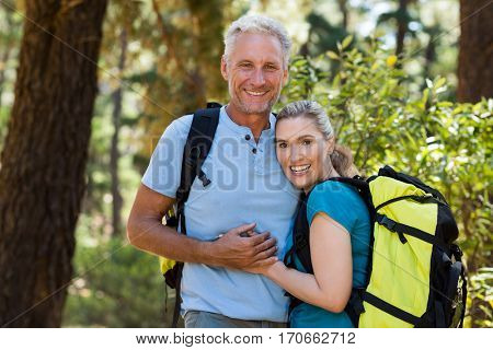 Couple smiling and holding each other on the wood