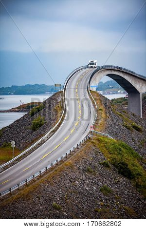 Caravan car travels on the highway.. Atlantic Ocean Road or the Atlantic Road (Atlanterhavsveien) been awarded the title as (Norwegian Construction of the Century).