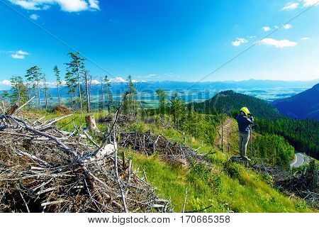 quad racer with helmet in highland landscape looking for his path