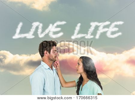 Digital composite of loving couple on graphic background