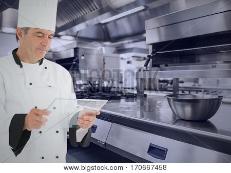 Close-up of chef using virtual screen against digitally generated kitchen