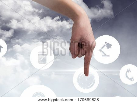 Hand touching digitally generated icons of cloud computing concept