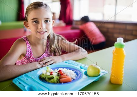 Child posing at the canteen at school