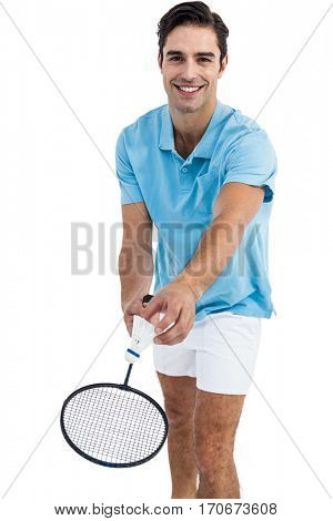 Badminton player holding a racquet ready to serve on white background