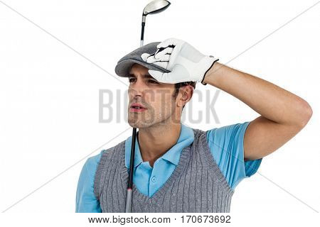 Golf player posing with golf club on white background