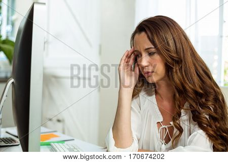 Frustrated businesswoman relaxing at desk in office in office