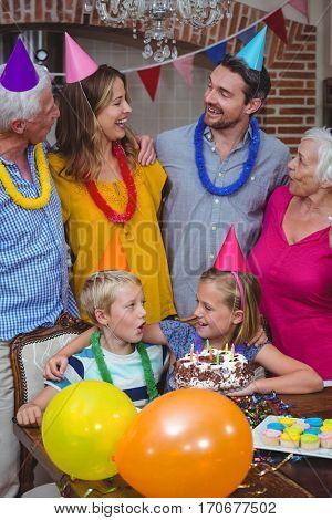 Smiling multi generation family celebrating birthday at home