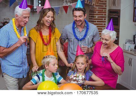 Happy multi generation family celebrating birthday at home
