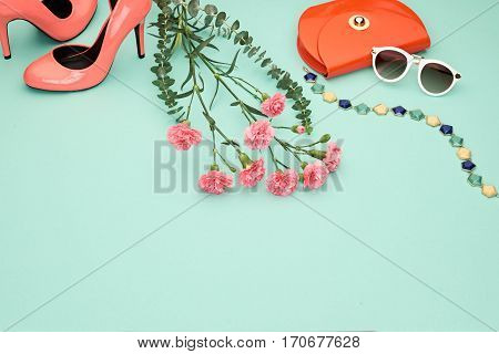 Spring Fashion Design girl clothes set, accessories. Trendy sunglasses, floral fashion, handbag clutch, flowers. Glamor shoes heels Summer lady.Creative urban. Pastel spring colors.Perspective view