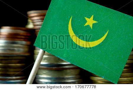 Mauritania Flag Waving With Stack Of Money Coins Macro