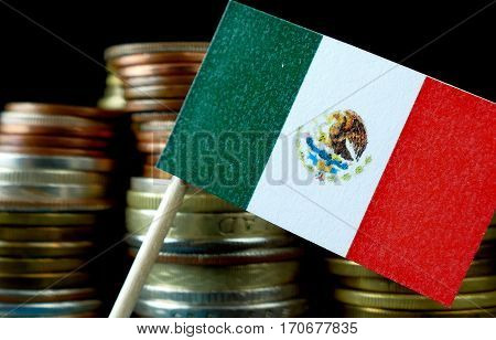 Mexico Flag Waving With Stack Of Money Coins Macro