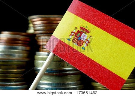 Spain Flag Waving With Stack Of Money Coins Macro