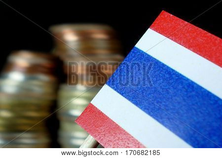 Thailand Flag Waving With Stack Of Money Coins Macro