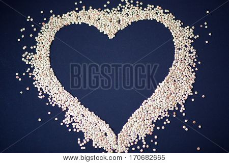 Heart Of Cereals And Pasta On A Blue Background. Pasta And Cereals.